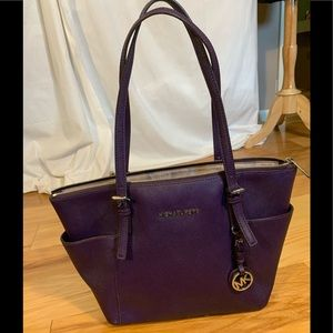 Micheal Kors purple saffiano leather tote.